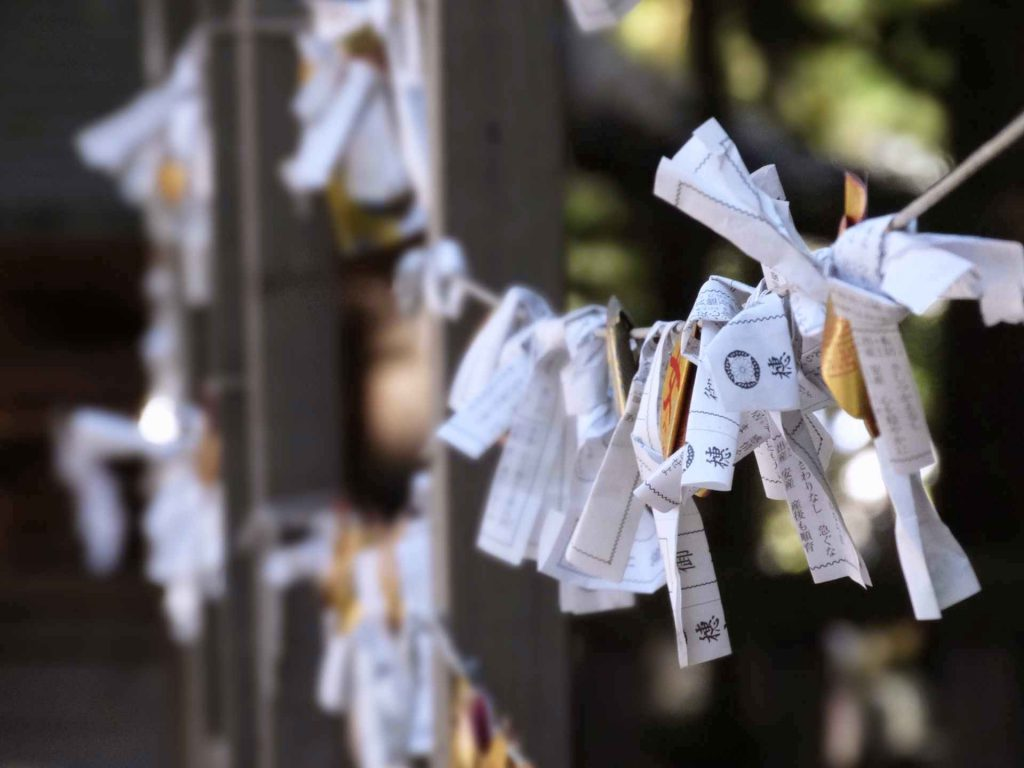 Omikuji tied to ropes in a shrine