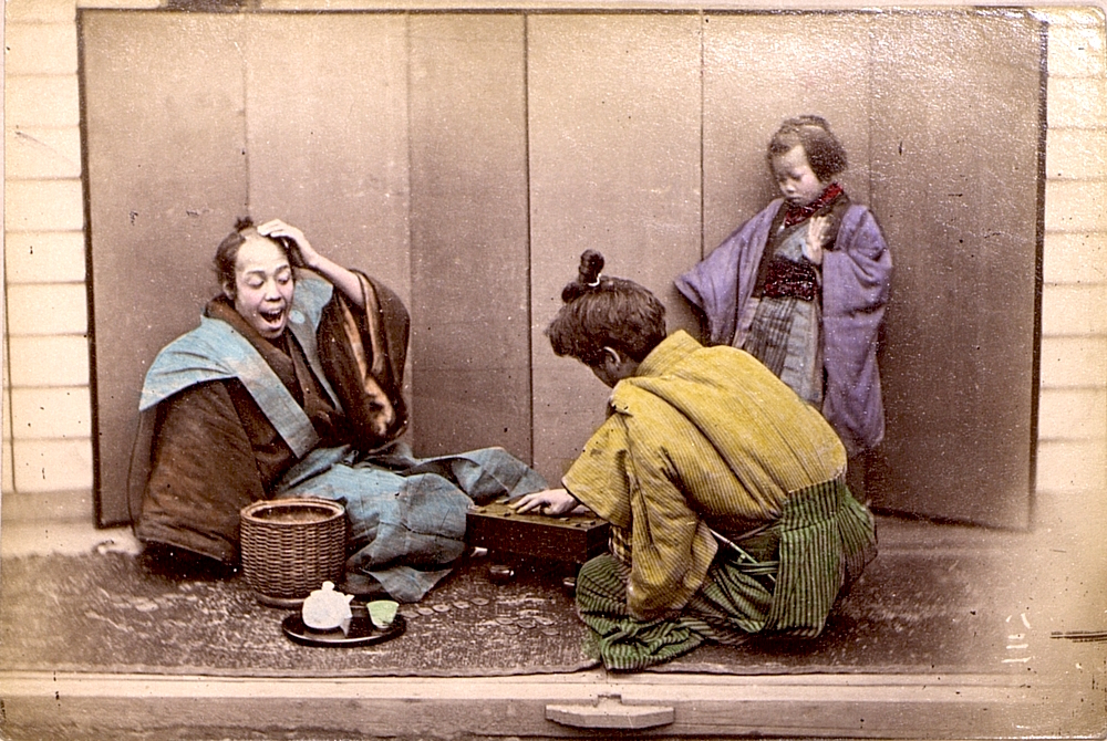 Two men attired as Samurai playing Shogi