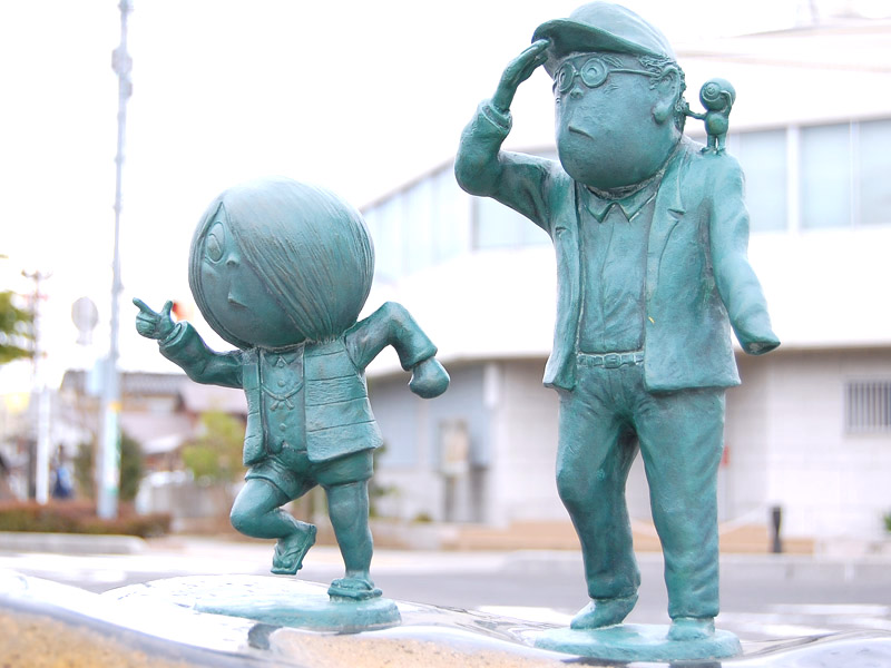 Statues of Kitaro, Mizuki-san, and Medama-no-Oyaji in Mizuki Shigeru Road
