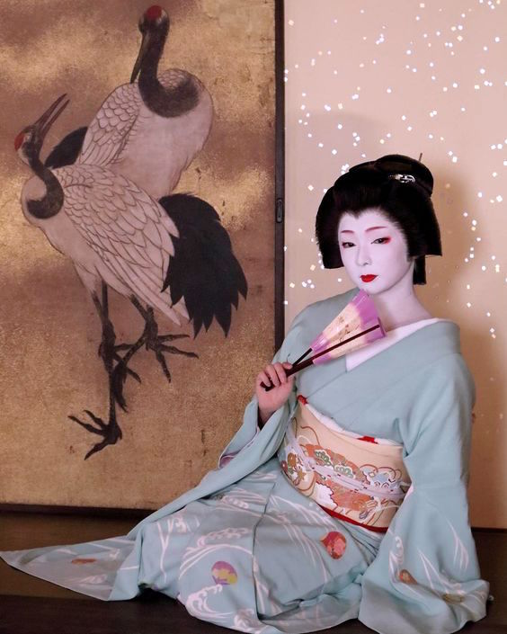Geiko Toshimana (Komaya Okiya) of Miyagawacho dancing with a mai ougi, a dancing fan