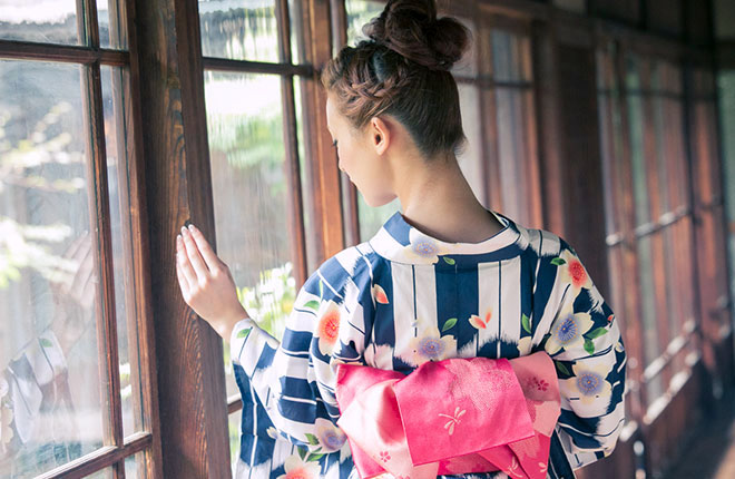 A woman's back in Japanese Traditional Casual Dress with pink Obi ribbon